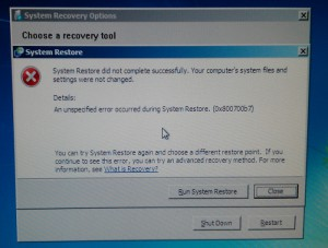 An unspecified error occurred during System Restore. (0x800700b7)